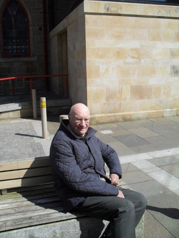Robert enjoying the sunshine as we wait for our bus.jpg