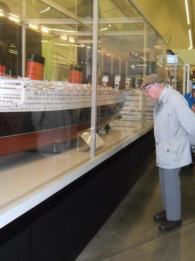 robert looking at the detail on the model ship.JPG