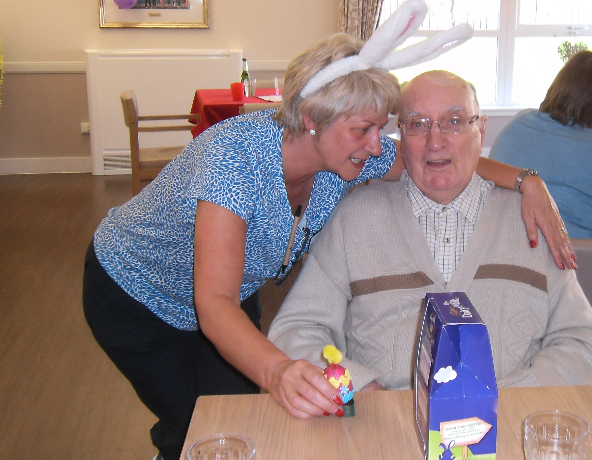 Margaret giving Robert his prize for the best decorated egg.JPG